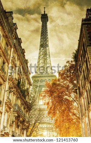 vintage style picture with a view on the Eiffel Tower in Paris between city buildings