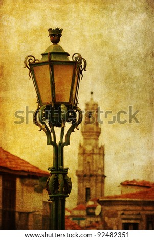 vintage style picture with an ancient street lamp and an old church in the background