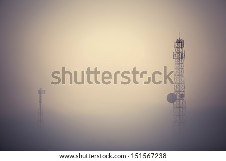 Vintage style telecom tower in the morning mist