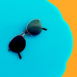 Vintage Stylish Sunglasses on bright background