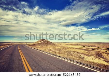 Vintage stylized empty road, travel concept, USA.