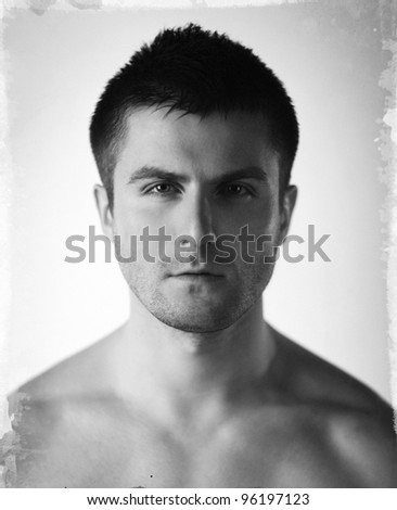 Vintage stylized fine art close-up black and white portrait of beautiful young man, shallow deep of field