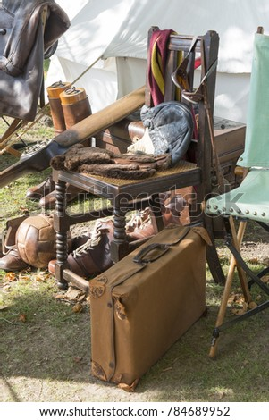 Vintage suitcase, football, shoes, and other antiquities #784689952