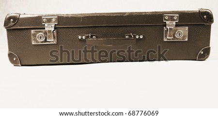 Vintage suitcase in sepia on white background with space for your text