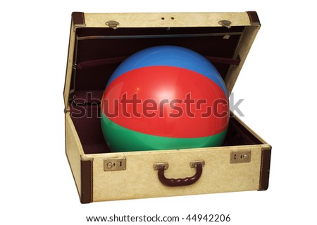 Vintage suitcase with a colorful ball