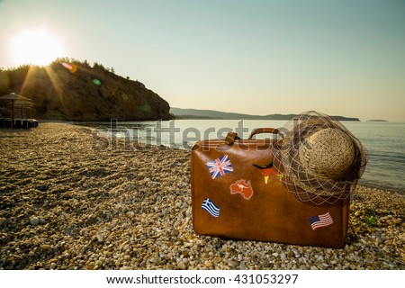 vintage suitcase with flag...