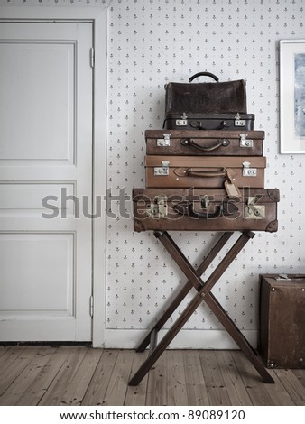 Vintage suitcases nicely stacked in old environment