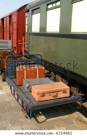 vintage suitcases on trolley at ...