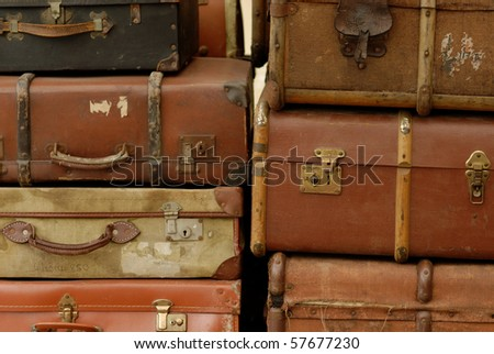 vintage suitcases stacked for...