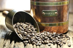 vintage Swedish coffee can with manufacture roasted Indonesian Arabica coffee beans on rustic wooden background (translation: coffee)