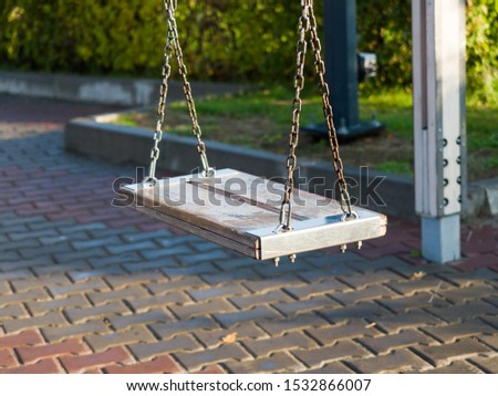 Vintage swing in a city square. Comfortable urban environment