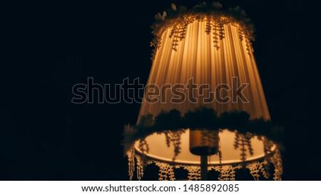 Vintage table lamp illuminated, Elegant Chandelier illuminated