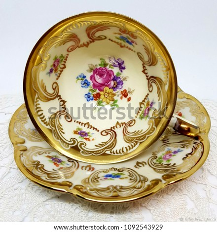 vintage tea cup with plate on white background #1092543929