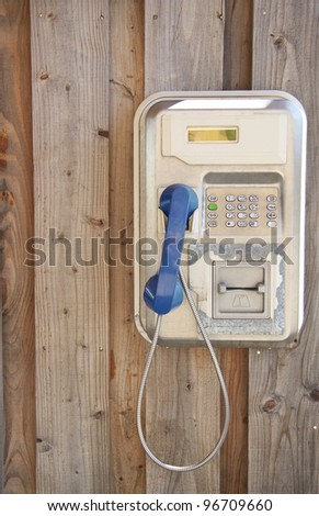 Vintage telephone hanging on wooden wall for background use