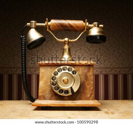 Vintage telephone over retro background