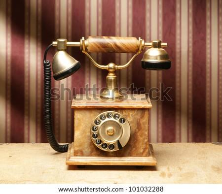 Vintage telephone over retro background