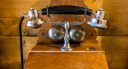 Vintage telephone without a common battery exchange had a magneto hand-cranked generator to produce a high voltage alternating signal to ring bells of telephones on the line, to alert the operator.