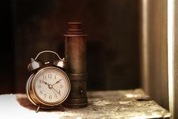Vintage Telescope and Clock on Wood Texture