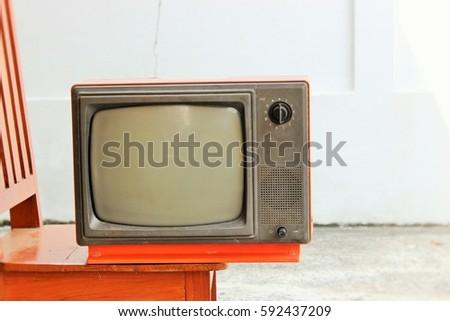Vintage television - old orange TV retro technology #592437209