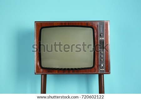 Vintage television on color background #720602122