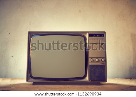 Vintage television on wood table #1132690934