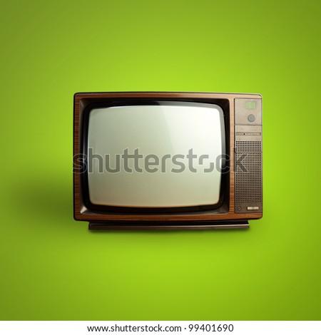 vintage television over green background