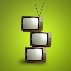 vintage television pile over green background