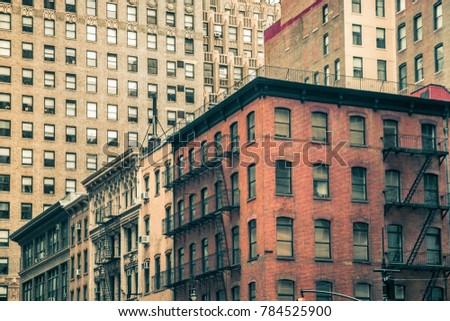 Vintage tenement buildings and modern buildings in the background, New York City