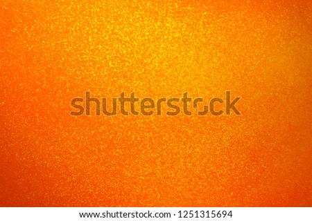 Vintage texture of yellow orange wall for design backdrop. Concrete walls in paint splashes. Illuminated surface. Bright background. Raster image.