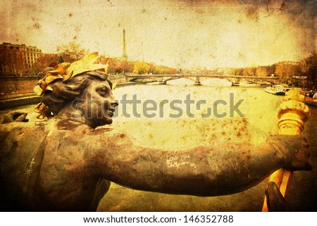 vintage textured picture of a sculpture of an angel at a bridge in Paris