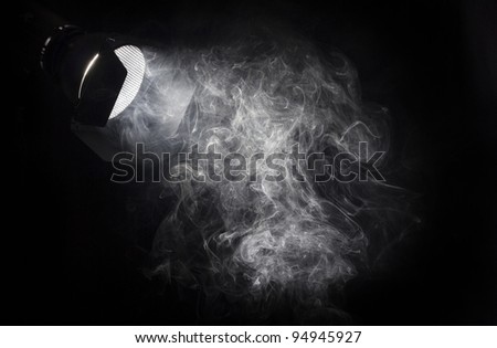 stock-photo-vintage-theater-white-spot-light-beam-from-projector-on-black-background-illuminating-smoke-barn-94945927.jpg