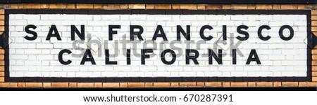 vintage tiled sign at a railway ...