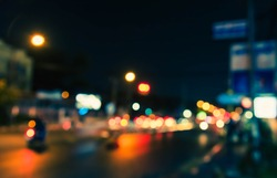 Vintage tone abstract blur image of Road in night time with light bokeh for background usage .