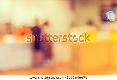 Vintage tone Abstract blur image of  Shopping mall with bokeh for background usage . #1285646698