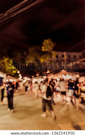 Vintage tone  abstract blur image of Street night market in garden with bokeh for background usage . #1362141950