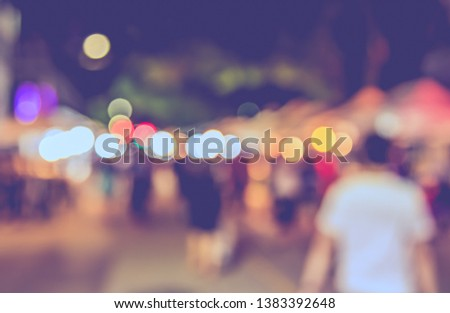 Vintage tone  abstract blur image of Street night market in garden with bokeh for background usage . #1383392648