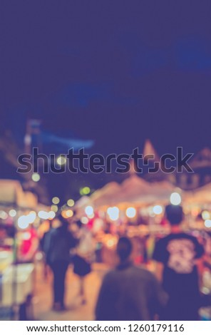 Vintage tone  abstract blur image of Street night market with bokeh for background usage . #1260179116