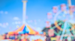 Vintage tone Abstract Blurred image of Theme park on day time with bokeh for background usage .