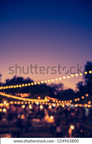 vintage tone blur image of night festival in garden with bokeh for background usage . #524963800