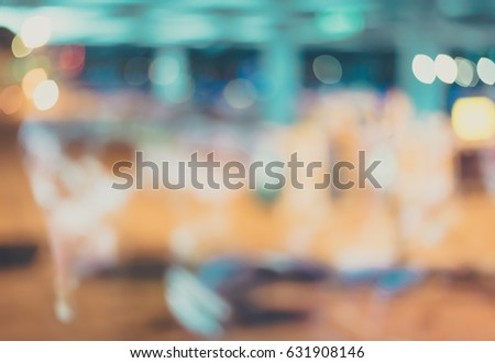 vintage tone blur image of passengers in airport terminal in window reflect angle for background.