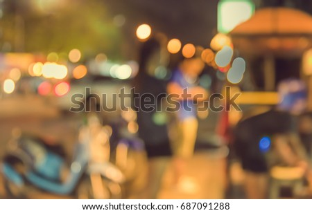 vintage tone image of blur night market on street with bokeh for background usage . #687091288