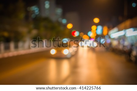 vintage tone image of blur street bokeh with colorful lights in night time for background usage . #414225766