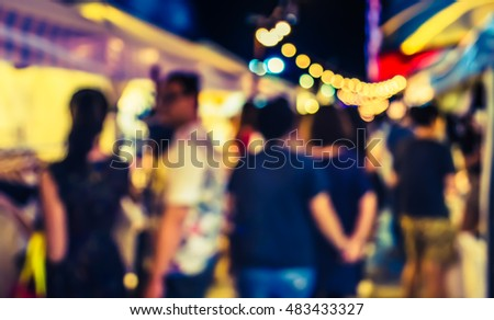 vintage tone image of night festival on street blurred background with bokeh .