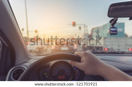vintage tone image of people driving car on day time for background usage.(take photo from inside focus on driver hand) ストックフォト ©