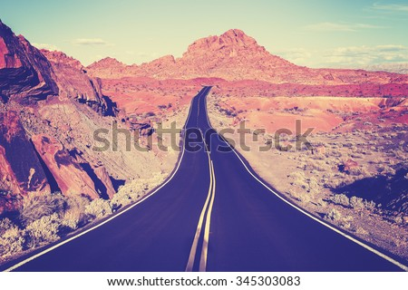 Vintage toned curved desert highway, travel concept, USA.