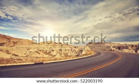Vintage toned desert road just before sunset, travel concept, USA.