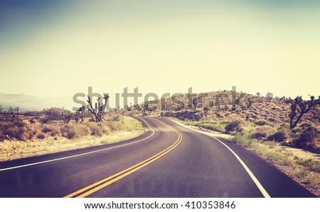 vintage toned desert road seen...