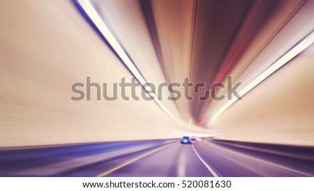 Vintage toned motion blurred car driving in tunnel, drunk driver vision concept.