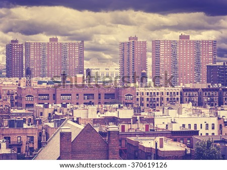 Vintage toned photo of New York residential buildings in rainy day, Harlem, USA.