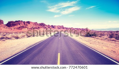 Vintage toned picture of a desert road, travel concept, Valley of Fire State Park, Nevada, USA.